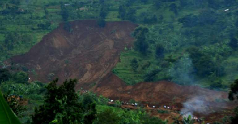 Dangerous soil: File picture from 2012 of a landslide in Bududa in which at least 18 people died.  By ISAAC KASAMANI (AFP)