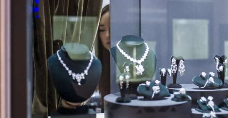 A exhibitor checks a display prior to the opening of the Hong Kong Jewellery and Gem fair at the Convention and Exhibition Centre in the city on September 17, 2014.  By Xaume Olleros (AFP)