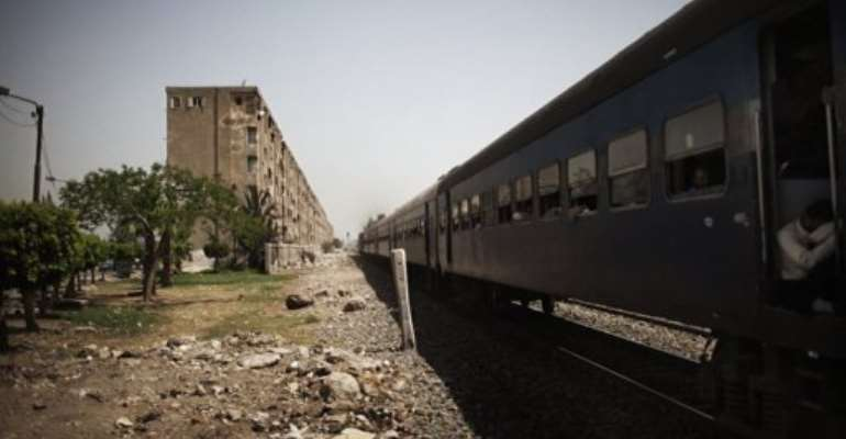 A train passes through the Egyptian Delta region, 50 kms north of the capital Cairo, in May.  By Marco Longari (AFP/File)