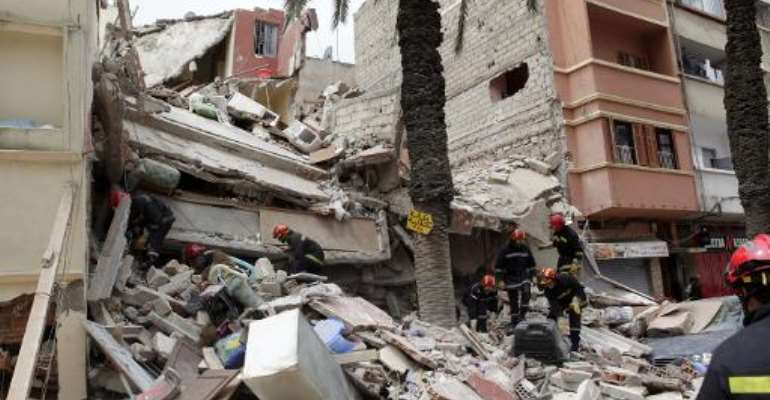 Moroccan rescuers inspect the rubble of a residential building that collapsed in Casablanca on July 11, 2014.  By - (AFP/File)
