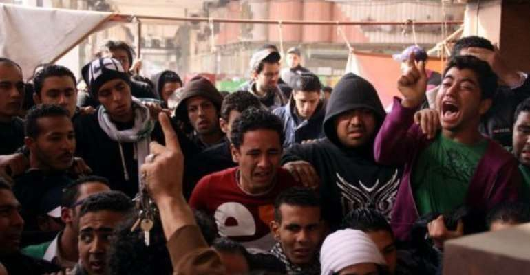 People protest in Egypt's Port Said on January 26, 2013 after a court in Cairo sentenced 21 people to death.  By  (AFP)
