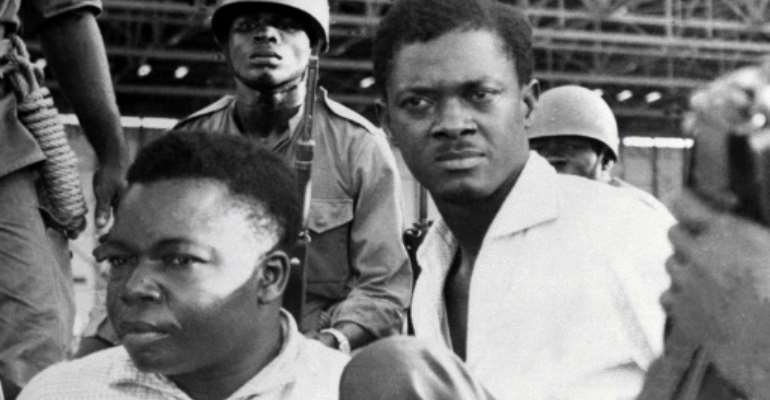 December 1960: Soldiers guard Congo's first post-independence prime minister, Patrice Lumumba, right, after his arrest. To the left is Joseph Okito, vice president of the Senate, who was shot dead alongside Lumumba the following month.  By STRINGER (AFP/File)