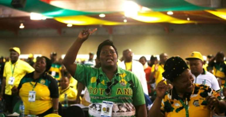 Delegates sing during the plenary session of the African National Congress.  By WIKUS DE WET (AFP)