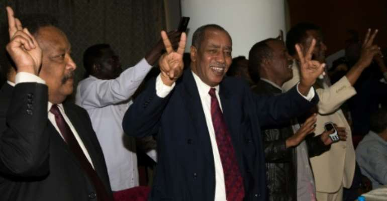 Delegation members of Sudan's transitional government react after two-week long peace talks with rebels in Juba in October.  By Akuot Chol (AFP)
