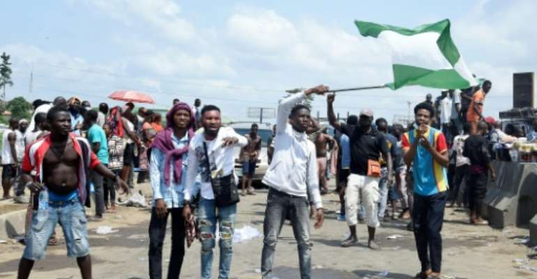 Demonstrations began on October 8, targeting a hated police unit, the Special Anti-Robbery Squad (SARS).  By PIUS UTOMI EKPEI (AFP)