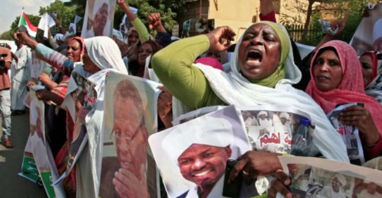Demonstrators carried Sudanese flags and photographs of detained former regime officials, calling for their release.  By Ebrahim HAMID (AFP)