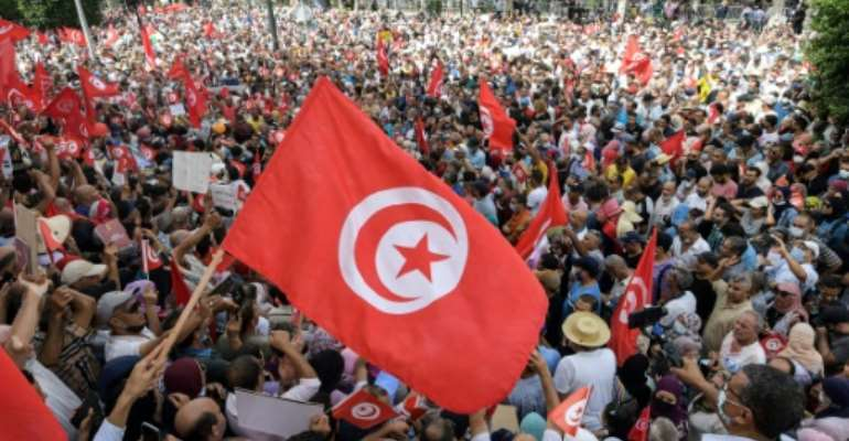 Demonstrators chant slogans during a protest in Tunisia's capital Tunis on September 26, 2021, against President Kais Saied's steps to tighten his grip on power.  By FETHI BELAID (AFP)