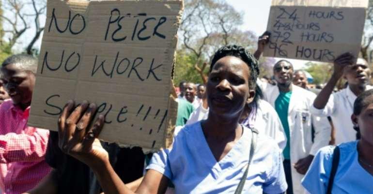 Demonstrators earlier this week chanted 'No Peter, no work'.  By Jekesai NJIKIZANA (AFP/File)