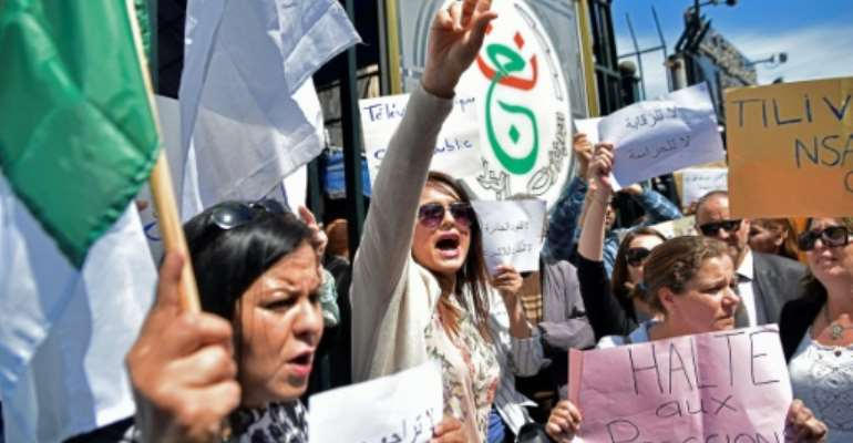 Demonstrators gather during a protest by state TV employees against censorship in the capital Algiers.  By RYAD KRAMDI (AFP)