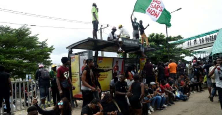 Demonstrators have made five demands that include structural police reforms and better pay for officers.  By PIUS UTOMI EKPEI (AFP)