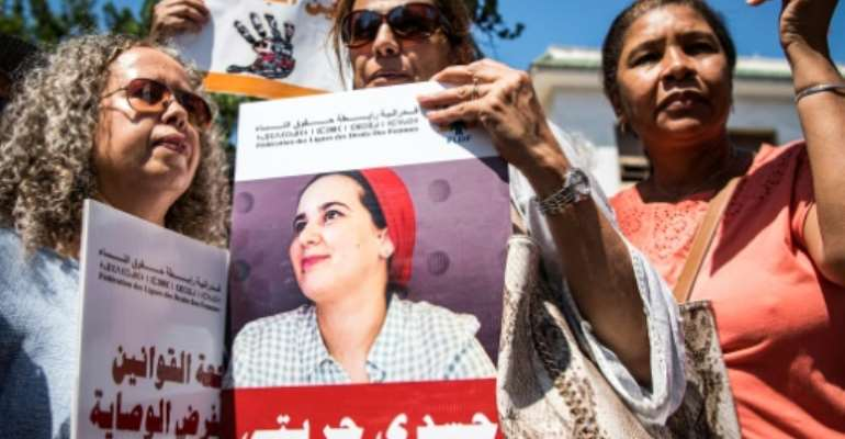 Demonstrators protested outside a Moroccan court as the trial opened of journalist Hajar Raissouni, accused of having a late-term abortion and sexual relations outside of marriage.  By FADEL SENNA (AFP)