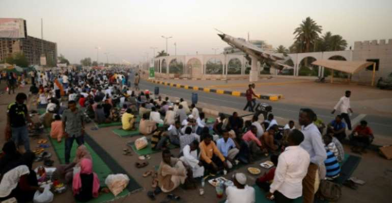 Demonstrators remain camped out in the soaring heat of Khartoum calling for civilian rule three weeks after the military ousted veteran leader Omar al-Bashir.  By MOHAMED EL-SHAHED (AFP/File)