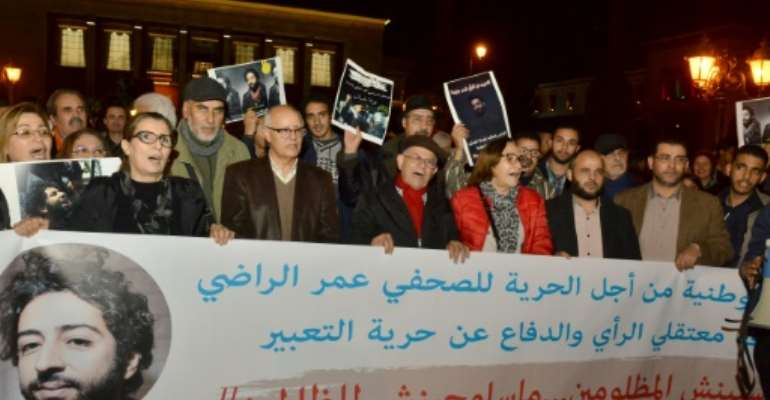 Demonstrators shout slogans during a protest in support of Omar Radi, a Moroccan journalist detained over tweet criticising a judge, on December 28, 2019, in the city of Rabat.  By STR (AFP/File)