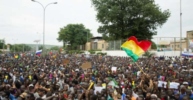 Demonstrators show their support for the military three days after rebel officers ousted President Ibrahim Boubacar Keita.  By ANNIE RISEMBERG (AFP)