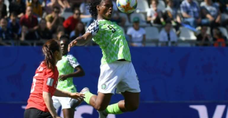 Desire Oparanozie (R) in action for Nigeria at the women's World Cup. She plays in France so Monday's clash with the hosts will be a particularly special occasion for her.  By Jean-Pierre Clatot (AFP)