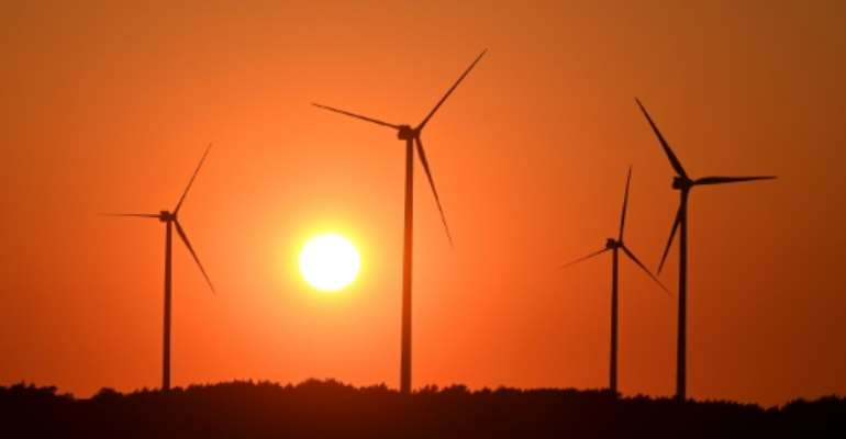 Despite a near-record drop in power demand due to the pandemic, renewables' share of the electricity mix was up 14 percent compared to the same period last year.  By Christof STACHE (AFP/File)