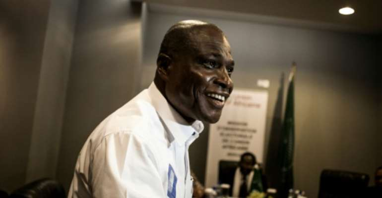 Despite being an outsider from a minor party, Martin Fayulu rapidly become one of the three leading candidates tipped to take over from Kabila after the December 30 elections.  By John WESSELS (AFP/File)