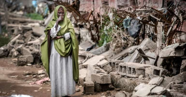 Devastation: A woman looks at the remains of the school in flood-hit Beledweyne.  By LUIS TATO (AFP)