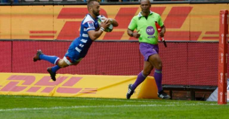 Dewaldt Duvenage scores a Super Rugby try for the Stormers before joining Italian club Benetton three years ago..  By ANDER GILLENEA (AFP)