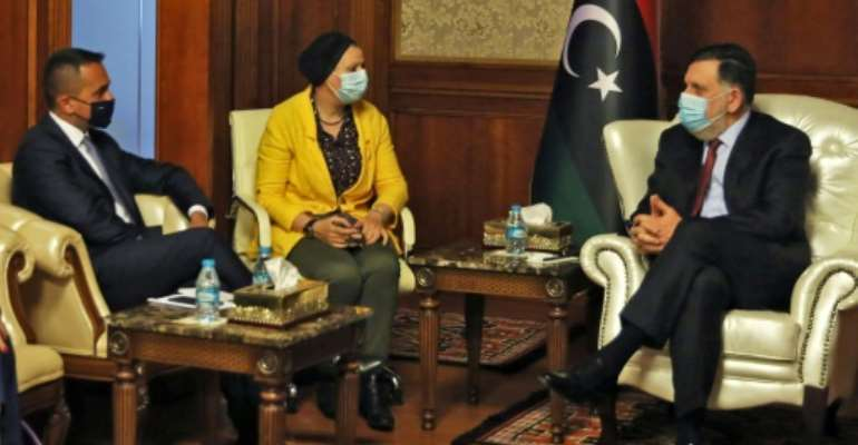 Di Maio (L) met Sarraj (R) during his first visit to war-torn Libya since January.  By - (AFP)