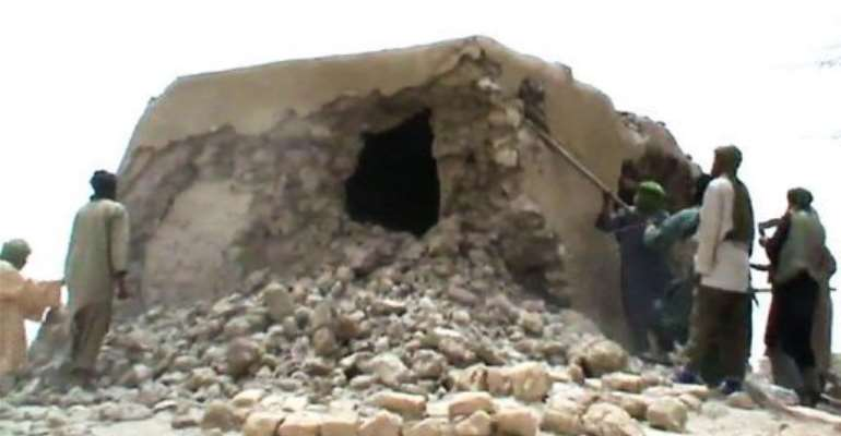 A still from a video shows Islamist militants destroying an ancient shrine.  By  (AFP)