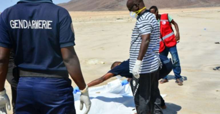 Djibouti has become a hub for migrants seeking to cross to Yemen and then seek work in the rich Gulf economies. Above: Police recover a body after two boats carrying migrants capsized in January 2019.  By Migane Megag (AFP/File)
