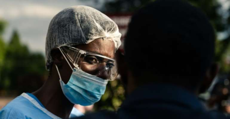 Doctors and nurses in Zimbabwe staged a walk-out in protest over a lack of protective clothing.  By Jekesai NJIKIZANA (AFP)
