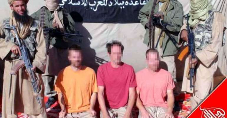An handout image released by Al-Andalus, the media branch of Al-Qaeda in the Magreb, shows three European hostages.  By  (AFP/ANI/File)