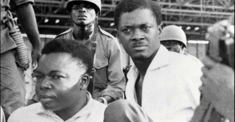 Downfall: Congolese independence hero Patrice Lumumba, right, and Joseph Okito, the vice president of the senate, pictured on their arrest in December 1960 in Leopoldville, now Kinshasa.  By - (AFP/File)