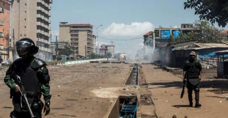 Dozens died in protests against a third term in office for President Alpha Conde.  By JOHN WESSELS (AFP/File)