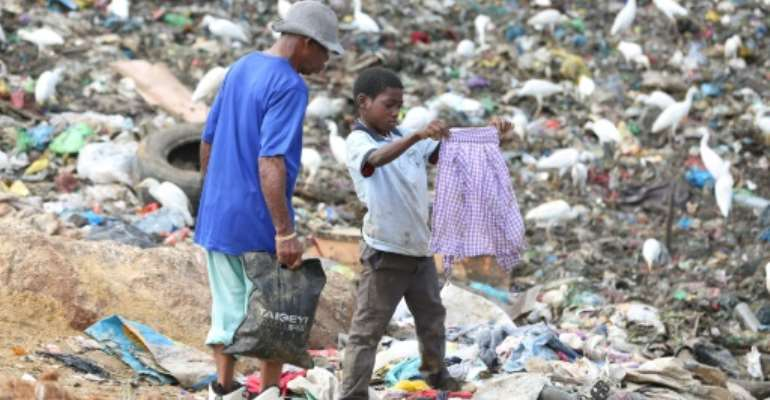 Dozens of children live and work around the Mindoube dump in Libreville.  By Steeve Jordan (AFP)