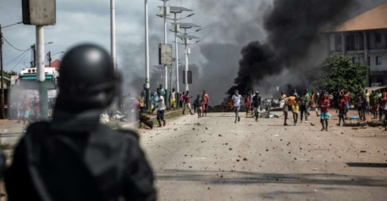 Dozens of people were killed during demonstrations, often in clashes with security forces.  By JOHN WESSELS (AFP/File)
