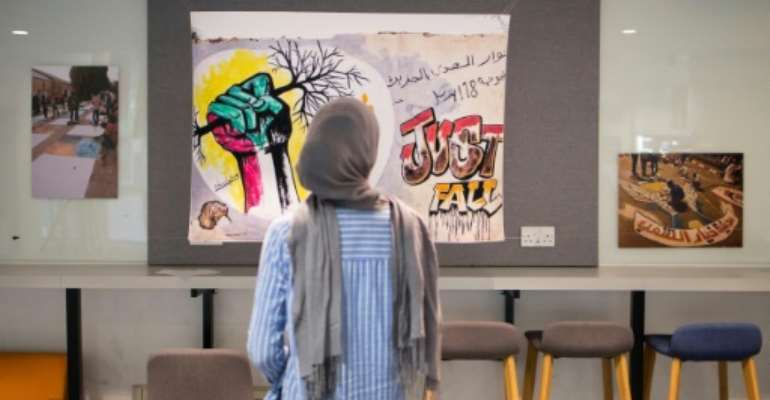 Dozens of photos of Sudanese protest art are  being exhibited at London's SOAS university.  By Tolga Akmen (AFP)