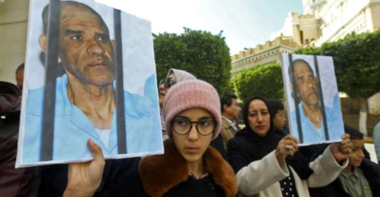 Dozens of Senussi's relatives protested Saturday in Libya's capital Tripoli.  By Mahmud Turkia (AFP)