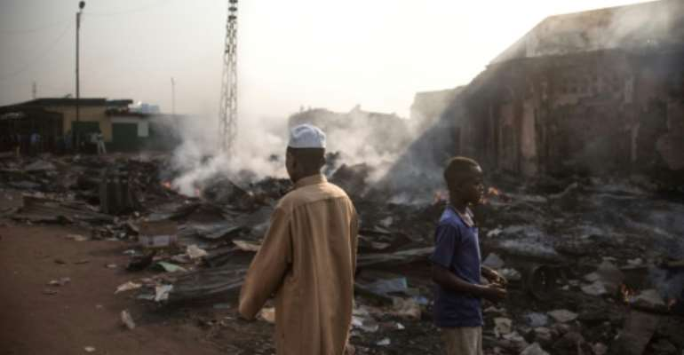 Dozens of stores have been burned down in Bangui's PK5 district, a flashpoint for violence in the Central African Republic.  By FLORENT VERGNES (AFP)