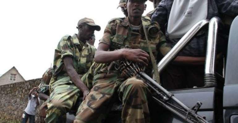 M23 rebels patrol the streets of Bunagana, on January 3, 2013.  By Isaac Kasamani (AFP/File)