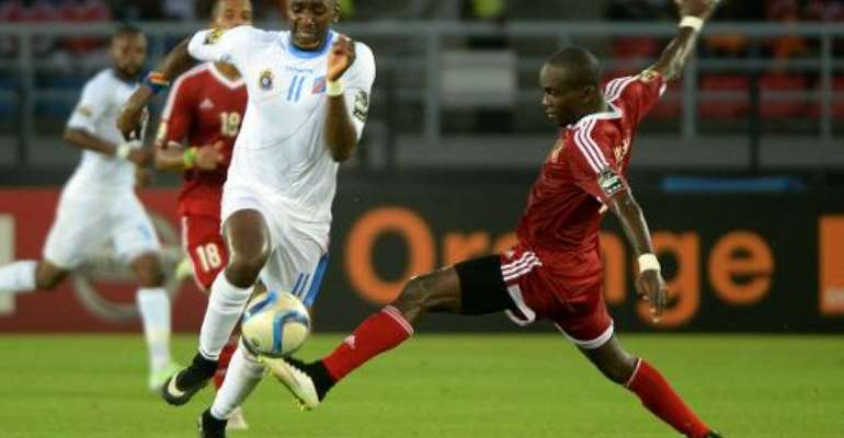 Democratic Republic of the Congo's forward Yannick Bolasie (L) vies with Congo's defender Boris Moubio Ngonga during their 2015 African Cup of Nations quarter final football match in Bata, on January 31, 2015.  By Khaled Desouki (AFP)