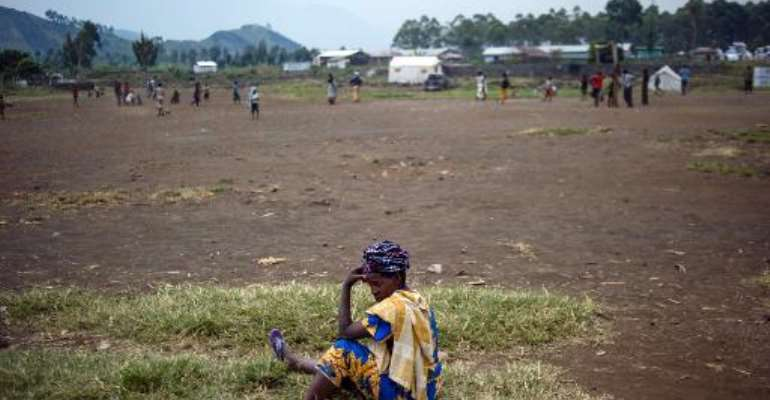 A displaced Congolese woman sits on July 14, 2014 in the Bulengo camp for internally displaced persons, 20 kms west of Goma in eastern DR Congo.  By Phil Moore (AFP/File)
