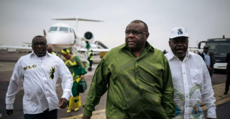 DR Congo opposition figure Jean-Pierre Bemba (C) made a low-key visit to the country.  By ALEXIS HUGUET (AFP)