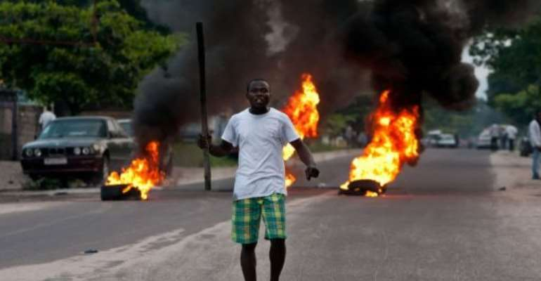 Violent protests and looting erupted in Kinshasa after Kabila was declared victorious.  By Gwenn Dubourthoumieu (AFP)