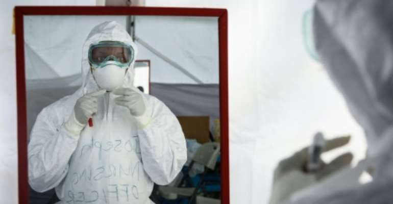 Ebola, which spreads among humans through contact with bodily fluids, is one of the most virulent tropical hemorrhagic fevers, often killing within days of infection.  By Isaac Kasamani (AFP/File)