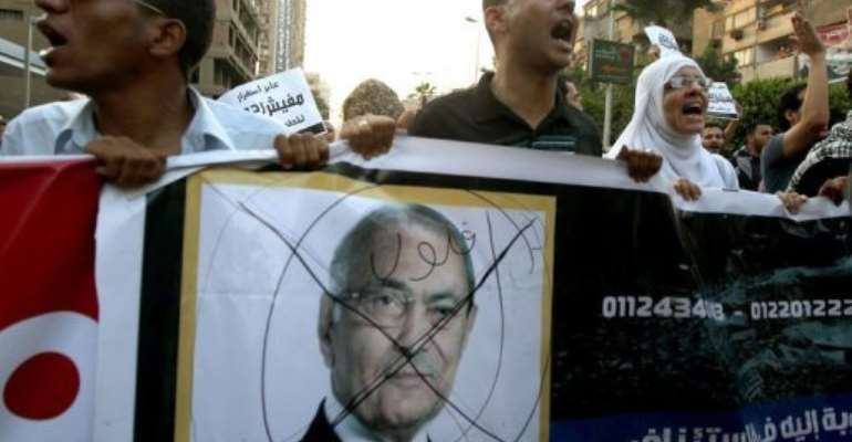 Egyptian protesters shout slogans against presidential candidate Ahmed Shafiq.  By Marwan Naamani (AFP)