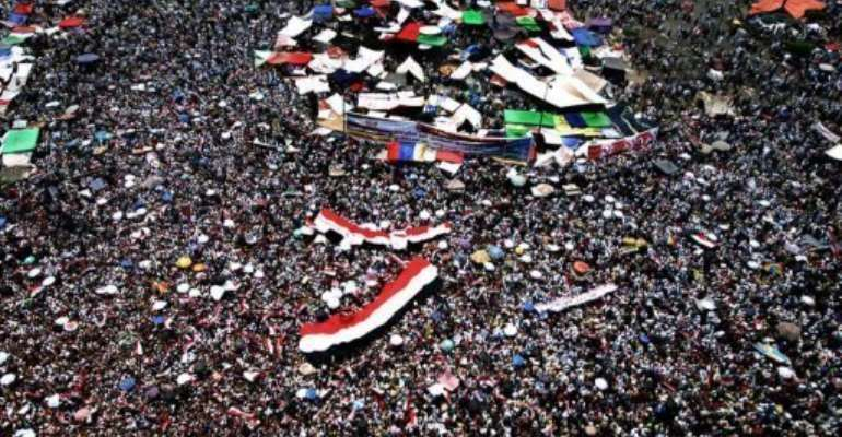 Supporters of the Muslim Brotherhood's presidential candidate pack Cairo's landmark Tahrir Square Friday.  By Marwan Naamani (AFP)