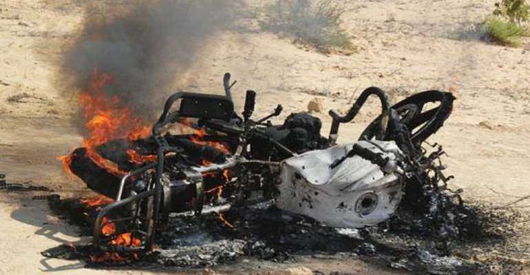 A motorbike burns after an earlier Egypt raid on the area. The military claims 23 have been arrested.  By Stringer (AFP/File)
