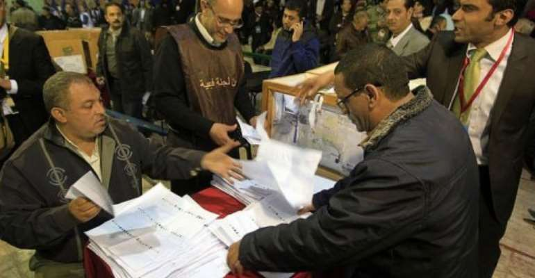 Egyptian election officials count ballots at the end of the second voting day.  By Mahmud Hams (AFP/File)