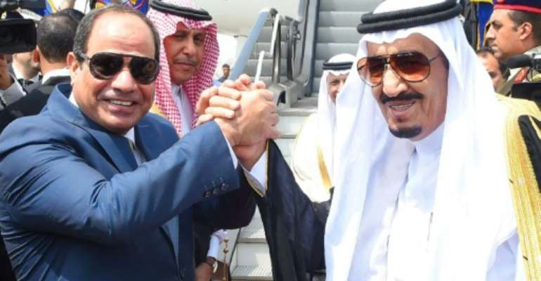 Egyptian President Abdel Fattah al-Sisi (left) sparked protests after he handed over two islands to Riyadh after trade talks with Saudi King Salman in April 2016.  By  (Egyptian Presidency/AFP/File)