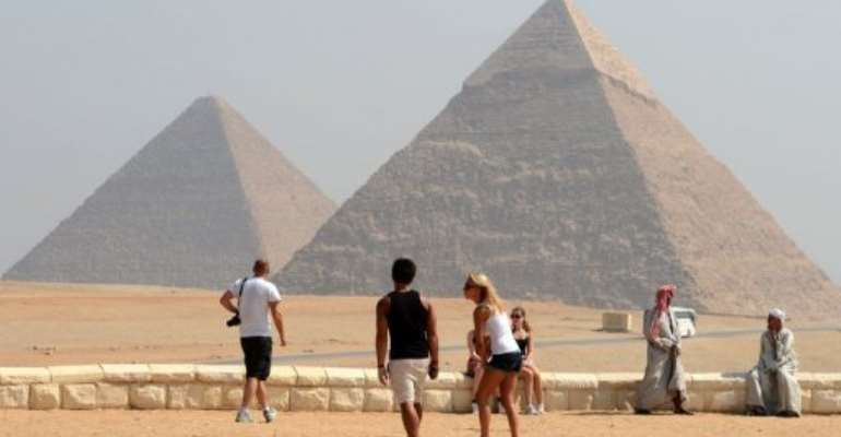 Foreign tourists visit the Giza pyramids, south of the Egyptian capital Cairo on October 1, 2012.  By Khaled Desouki (AFP/File)