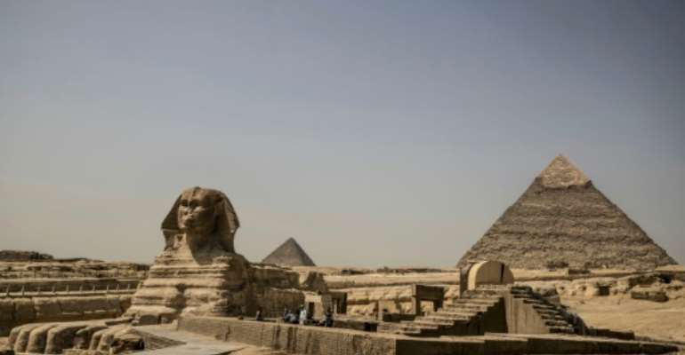 Egypt has been seeking ways to safely bring back tourists to its world-renowned archaeological sites which have been left deserted by coronavirus closures.  By Khaled DESOUKI (AFP/File)