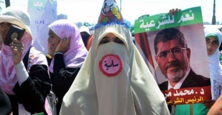 A supporter of Egypt's deposed president Mohamed Morsi attends a demonstration in Alexandria, on August 3, 2013.  By  (AFP)