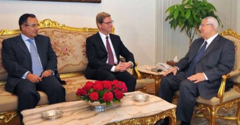 A handout picture from the Egyptian presidency on August 1, 2013 shows Interim president Adly Mansour (R) in Cairo.  By  (EGYPTIAN PRESIDENCY/Handout/AFP/File)